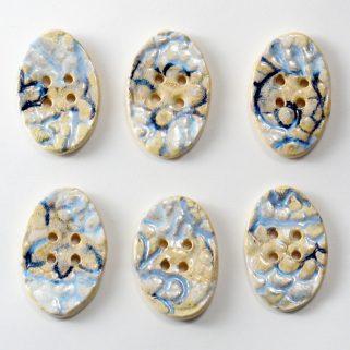 Guzik ceramiczny owalny błękitno-beżowy, ręcznie robiony