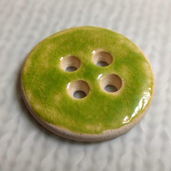 Zielony guzik ceramiczny