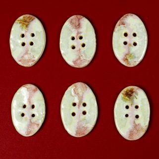 Guzik ceramiczny owalny różowo-biały dekoracyjny dodatek
