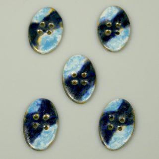 Guzik ceramiczny owalny granatowo-niebieski. Rękodzieło