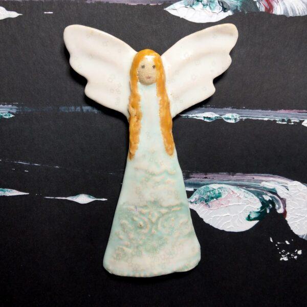 Anioł w turkusowej sukience